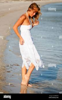 Young Blonde White Woman In Sundress Dipping