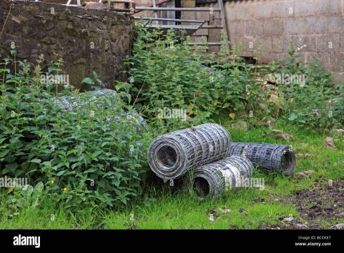 small resolution of roles of barbed wire fencing in a farm yard stock image