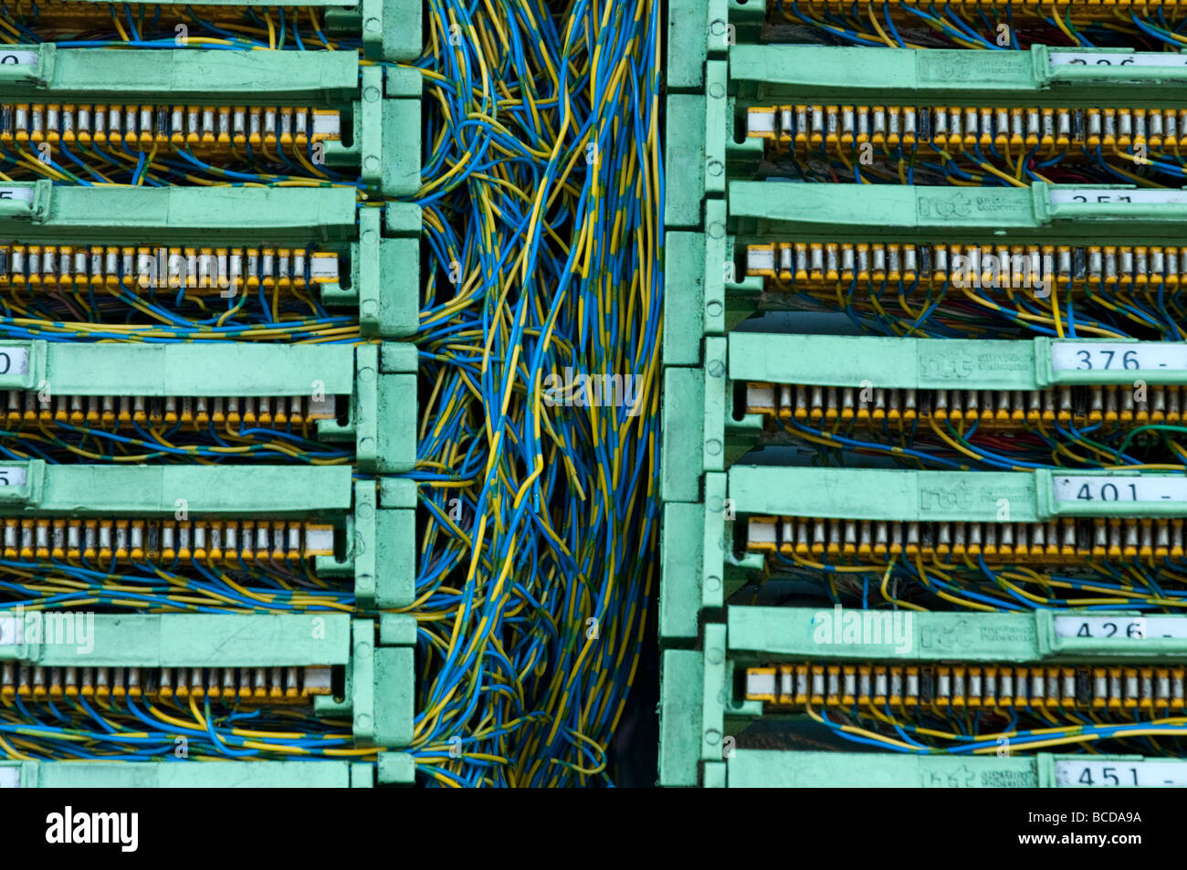 hight resolution of tangle of telecommunications wires inside phone junction box uk