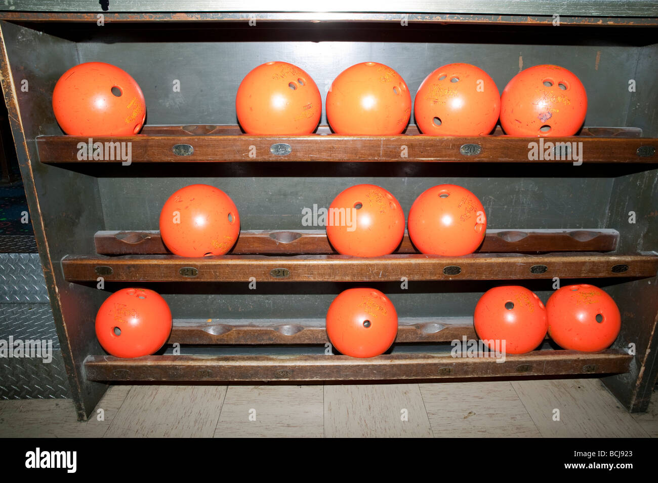 https www alamy com stock photo rack holding orange bowling balls at bowling alley 24988491 html