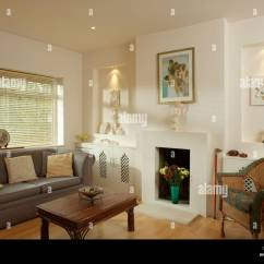 Furniture Ideas For Living Room Alcoves Modern Country Style Designs On Either Side Of Fireplace In Cream With Gray Sofa And Wood Coffee Table Front Window