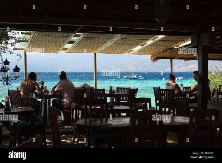 Indonesia, Lombok, Gili Trawangan, Beach House Resort, diners in waterfront  restaurant