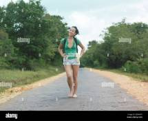 Barefoot Woman Walking Road