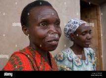 Hutu Woman And Tutsi Women Friends Stand