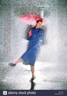 Woman Dancing In Rain Stock Royalty Free