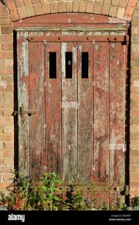 Old barn door and farm building close up England , UK ...