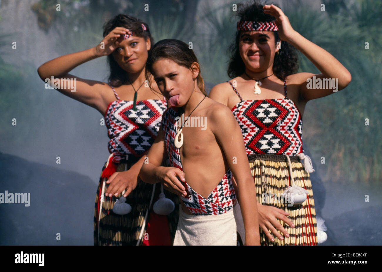 NEW ZEALAND Maori Children in costume performing Poi dance