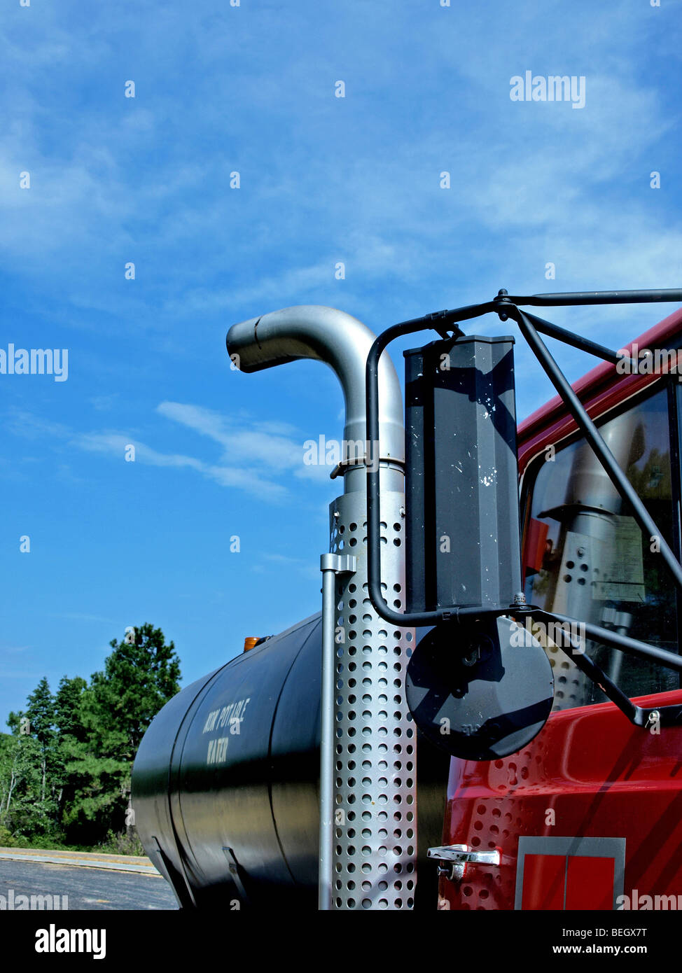 https www alamy com stock photo side view of large red and black truck that carries water with exhaust 26187388 html