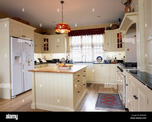 cream kitchen with islands Cream island unit and fitted cupboards in country kitchen