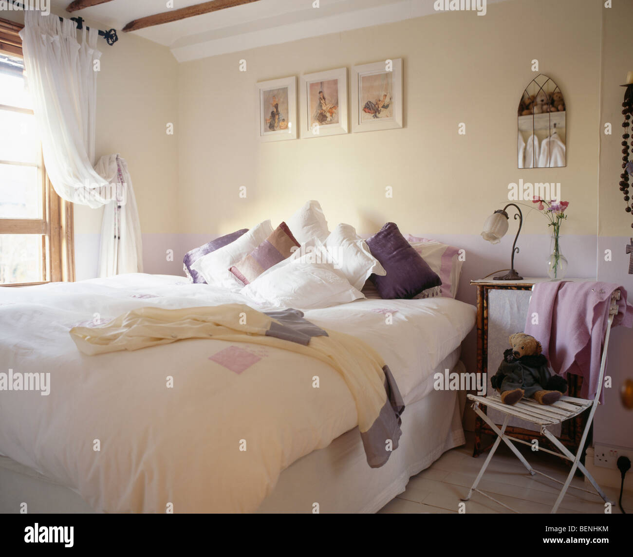bedroom chair for clothes x2 office bed piled with pillows in cream country thrown over small metal beside