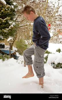Teenage Boy Walking Barefoot Snow Stock