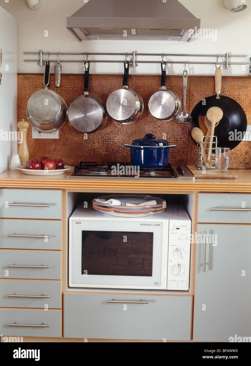 https www alamy com stock photo saucepans on rack above hob and microwave oven in gray fitted units 26538342 html