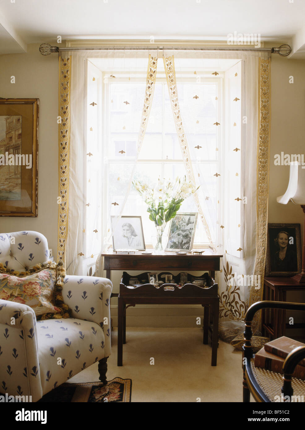Cream patterned armchair in small cottage living room with