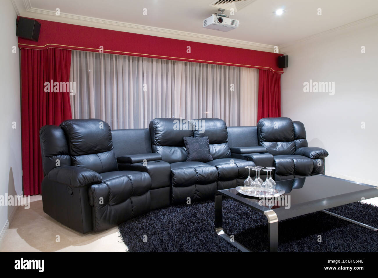 theatre room chairs little tikes table with drawers and 2 home theater black leather recliner red curtains rug wine glasses