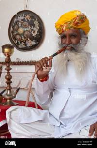 Indian man smoking hookah pipe Stock Photo, Royalty Free