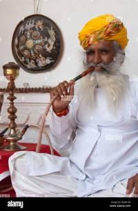 Indian man smoking hookah pipe Stock Photo, Royalty Free ...