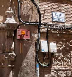electric wiring outside of an old house in recoletos street toledo spain  [ 975 x 1390 Pixel ]