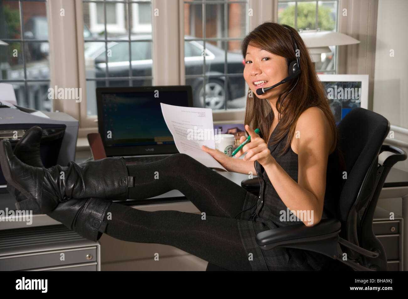 japanese office chair oversized reading young asian woman in feet on desk with phone