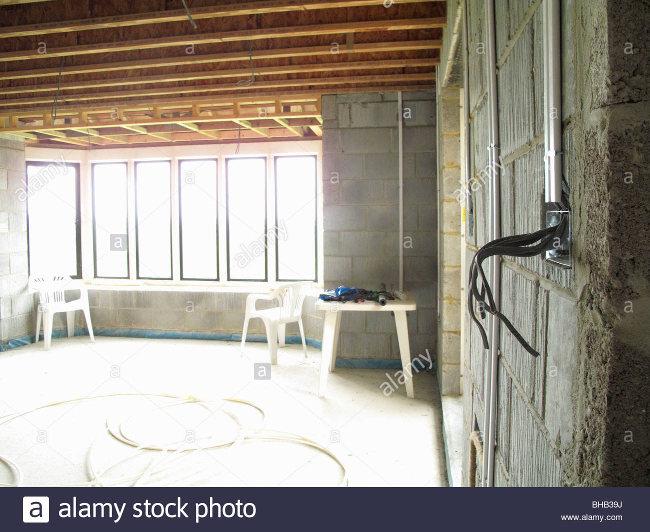 hight resolution of exposed electrical wires in house under construction