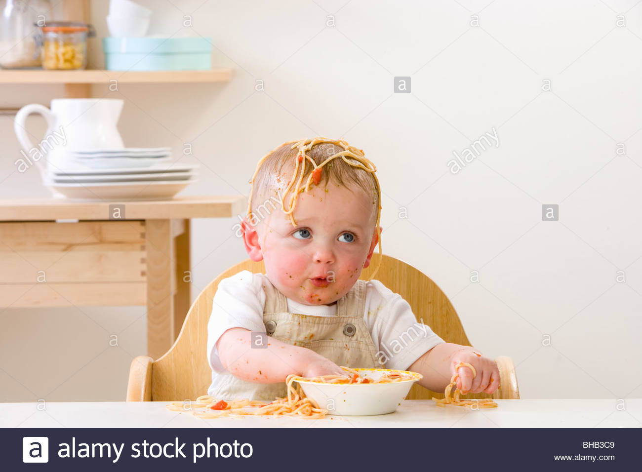 High Chair For Baby Boy Messy Baby Boy In High Chair Eating Spaghetti Stock Photo