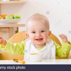 Baby Eating Chair Target Arm Happy Girl In High Stock Photo Royalty