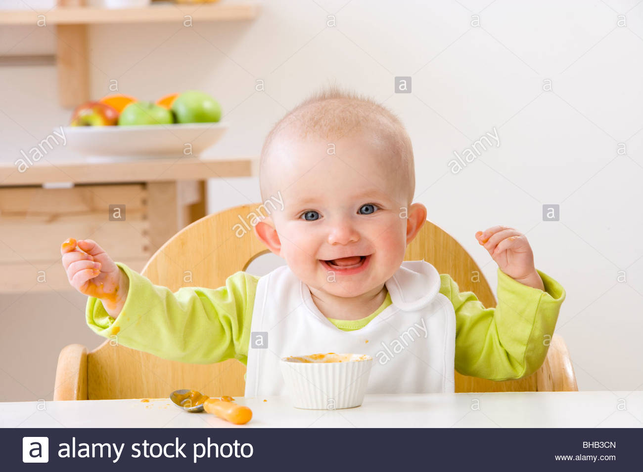 Baby Food Chair Happy Baby Girl In High Chair Eating Stock Photo Royalty