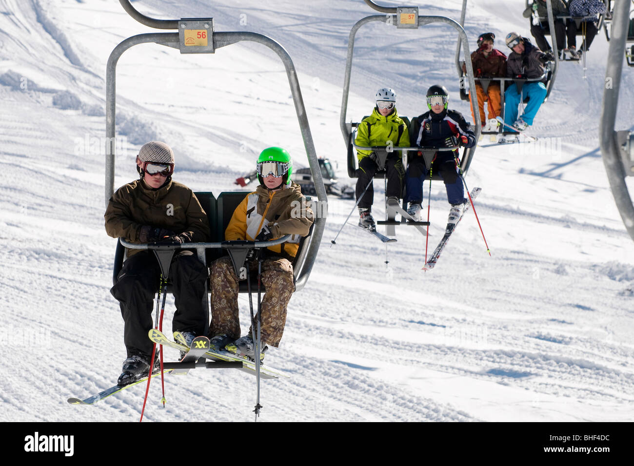 ski chair lift wedding cover hire cost young skiers on kitzbuhel austria stock photo