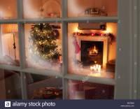 Christmas tree in living room behind window Stock Photo ...