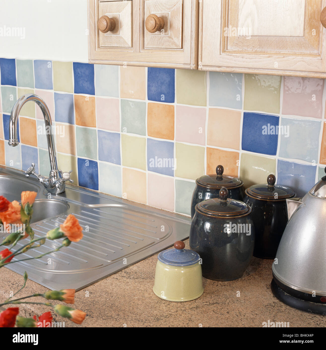 https www alamy com stock photo close up of pastel wall tiles above sink and worktop with black ceramic 28097126 html