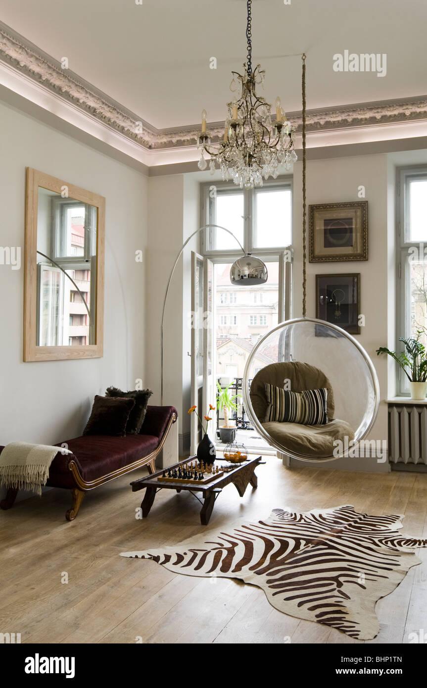 Eero Aarnio bubble chair in living room with zebra skin