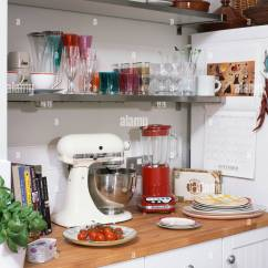White Kitchen Aid Wipes Close Up Of Red Kitchenaid Blender And Mixer On Wooden Worktop Below Glass Ware Shelves In Small