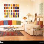 Brightly Colored Geometric Picture Above White Sofa With Colorful Stock Photo Alamy