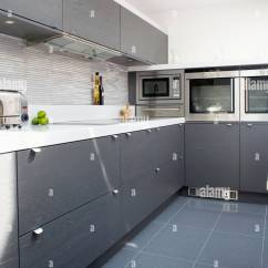 White Kitchen Floor Table With Rolling Chairs Grey Ceramic Tiles In Modern Dark Gray Fitted Cupboards And Units