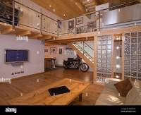 Modern contemporary sitting room with mezzanine balcony ...
