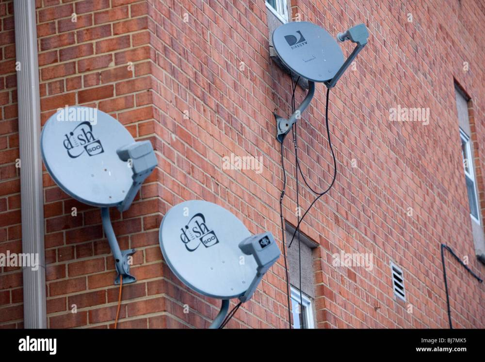 medium resolution of directv and dish network satellite dishes on an apartment building stock image