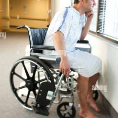 Wheelchair Man Office Chair Without Wheels In Hospital Gown Sitting Looking Through Window
