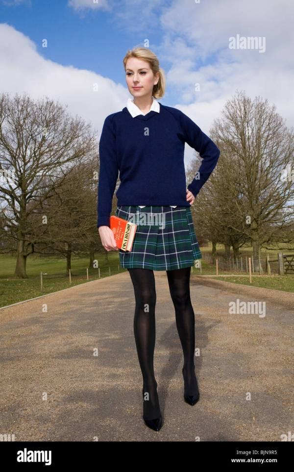 Blond Woman In Schoolgirl Uniform Wearing