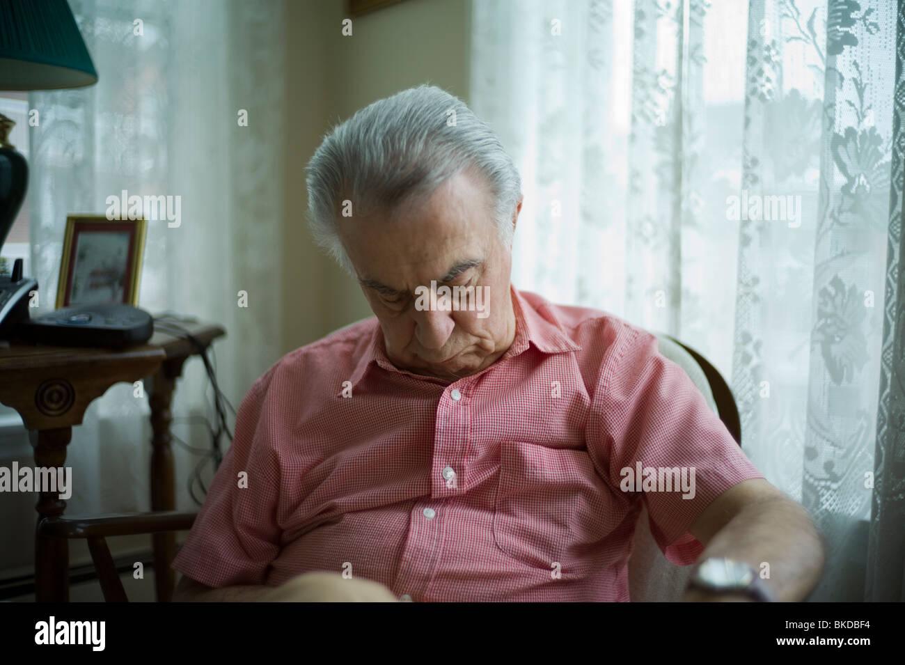 Old Man Sleeping Chair Stock Photos & Old Man Sleeping