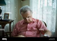 Old Man Sleeping Chair Stock Photos & Old Man Sleeping