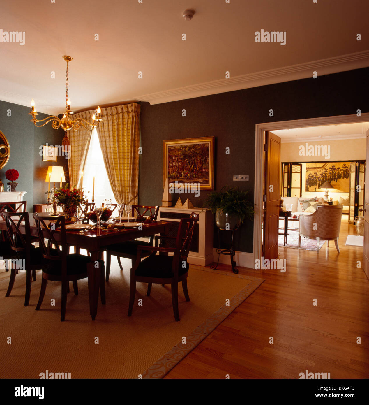 Wooden Flooring In Dark Green Traditional Dining Room With Antique Stock Photo Alamy