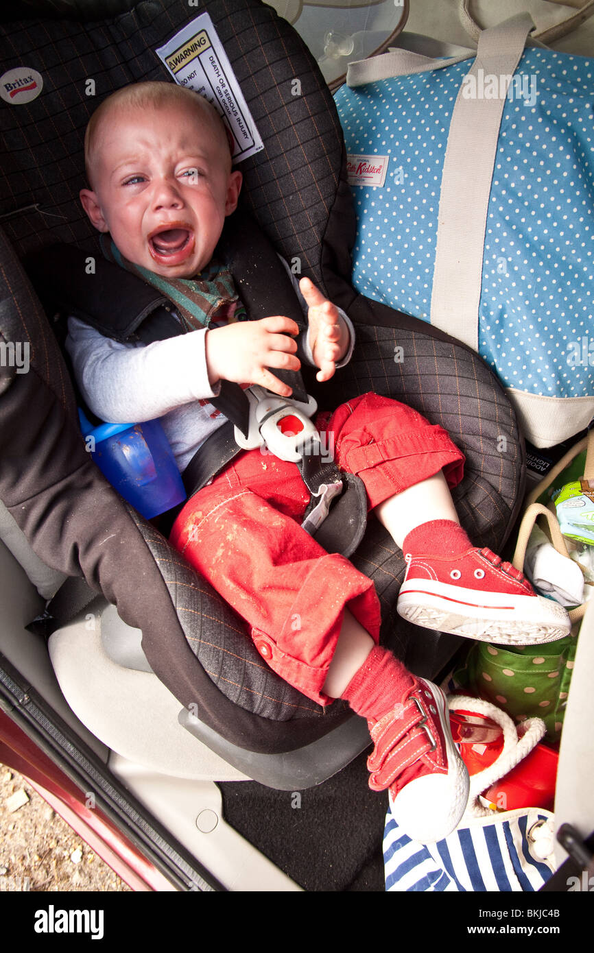 Baby Boy 1 Year Old In A Car Seat Crying For More Chocolate With A Stock Photo Alamy