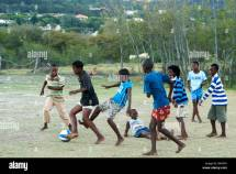 African Children Playing Soccer