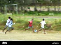 Barefoot Kids Playing Soccer