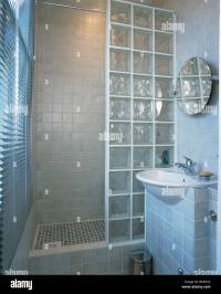 Glass brick shower wall in small modern tiled bathroom ...