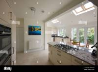 Wide angle view of a new modern kitchen extension with ...
