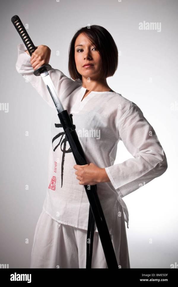 Female Martial Artist Wielding Katana Stock Royalty