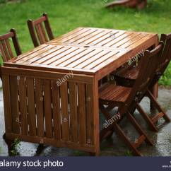 Outdoor Table And Chairs Wood Power Scooter Chair Garden Furniture Wooden Stock Photo