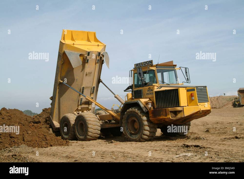 medium resolution of volvo dump truck working on a building site in england