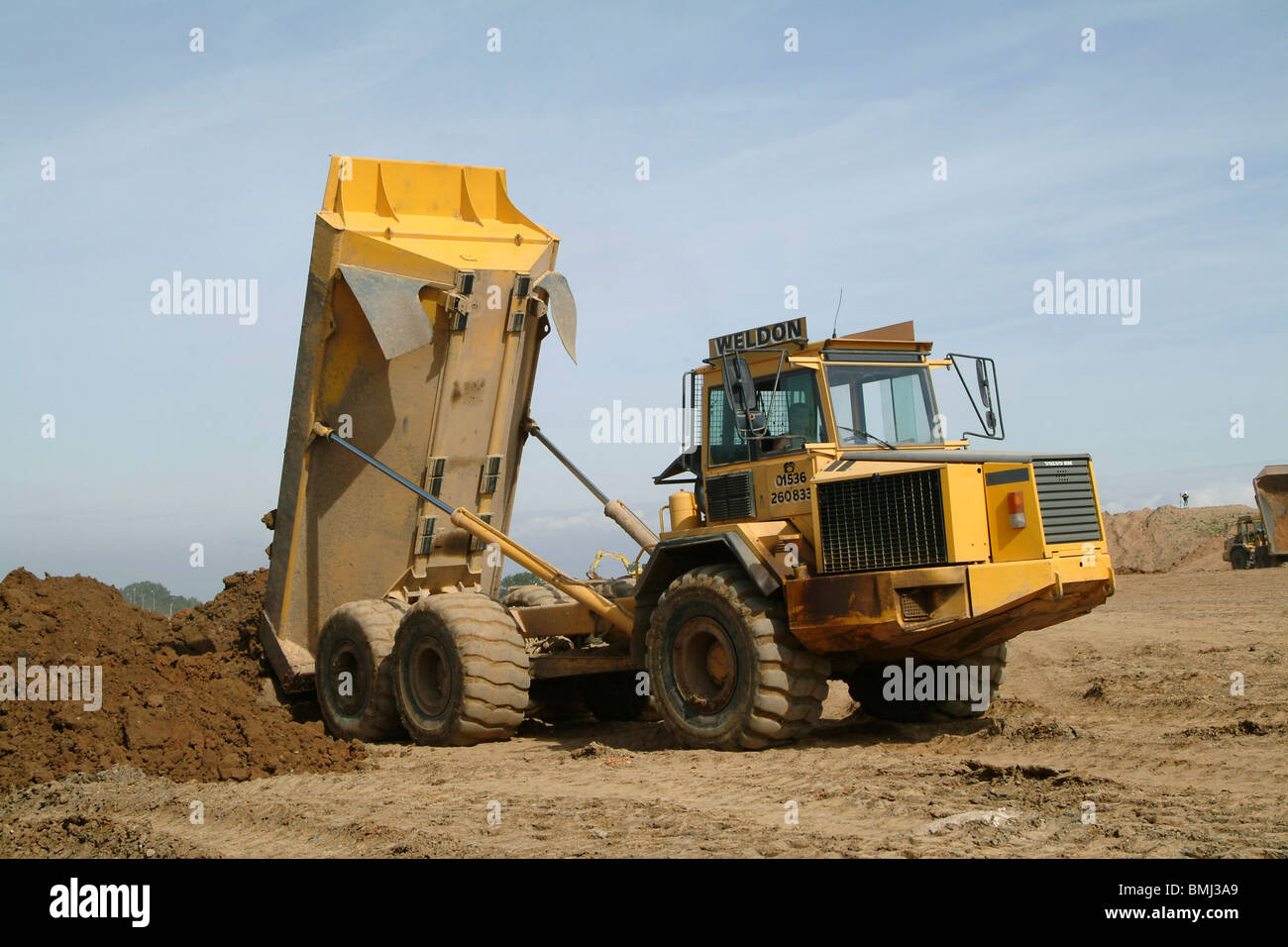 hight resolution of volvo dump truck working on a building site in england