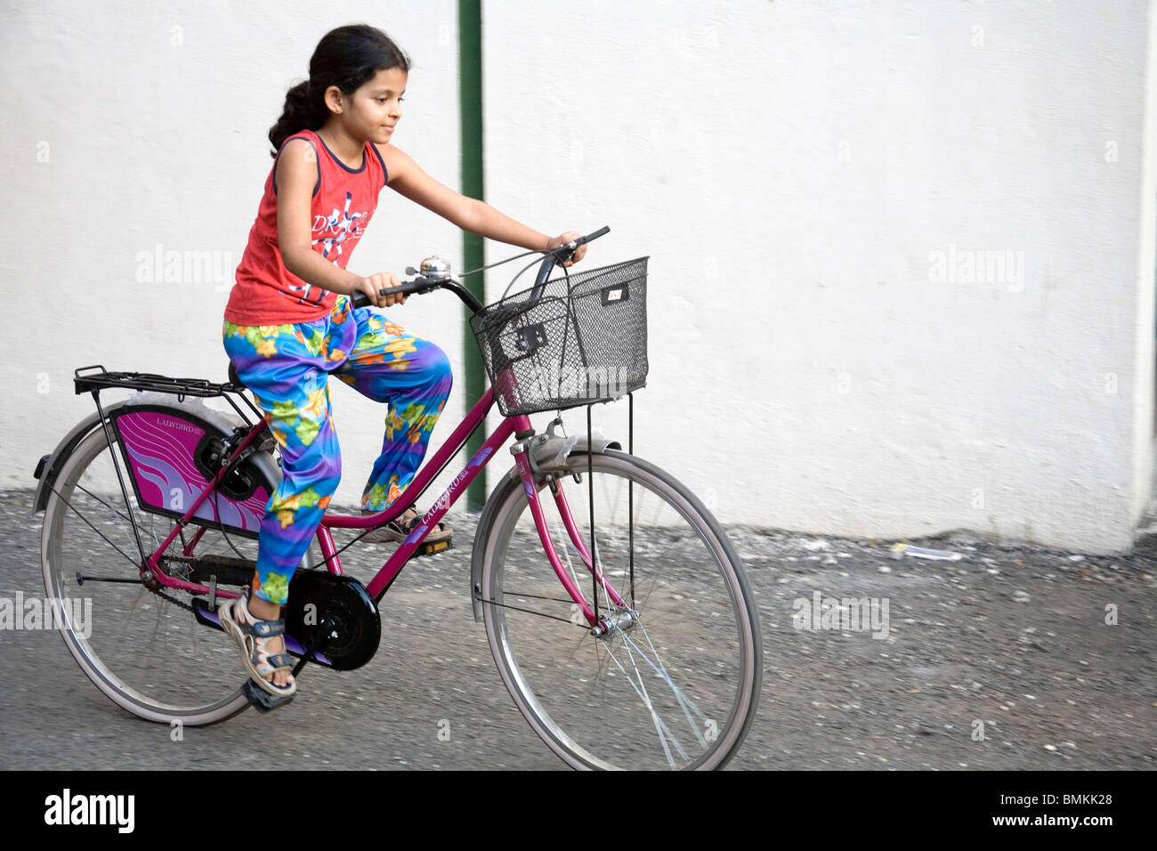 girl riding bicycle india